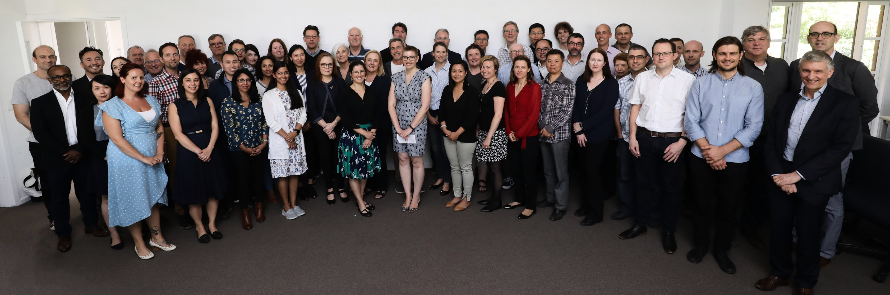 Group photo of female and male cancer researchers and scientists